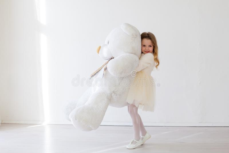 Beautiful girl with soft toy big bear. Beautiful girl with soft toy big polar bear stock photos