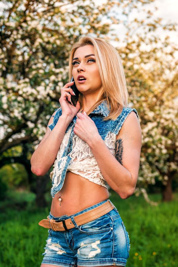 Beautiful girl speaks by phone royalty free stock photos