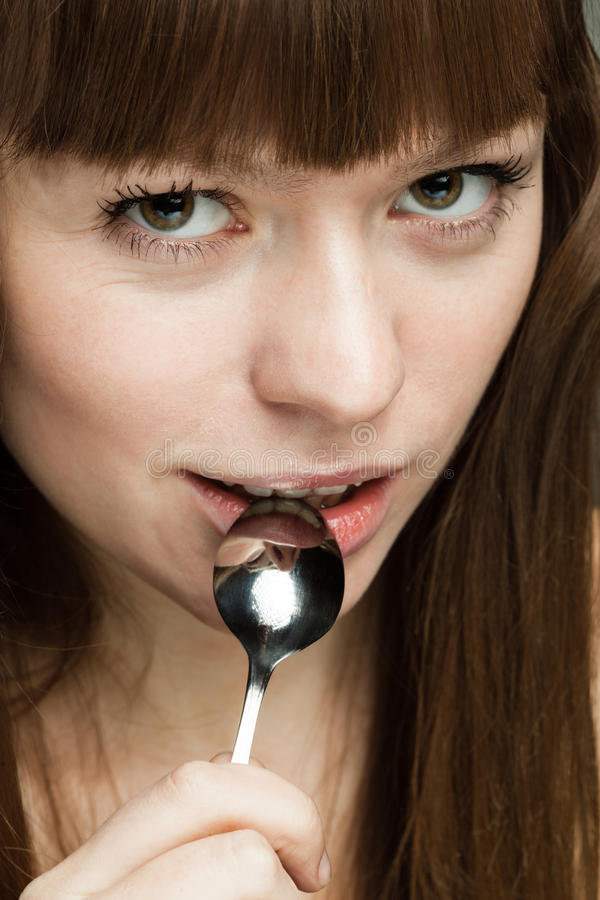 Beautiful girl with a spoon stock photography