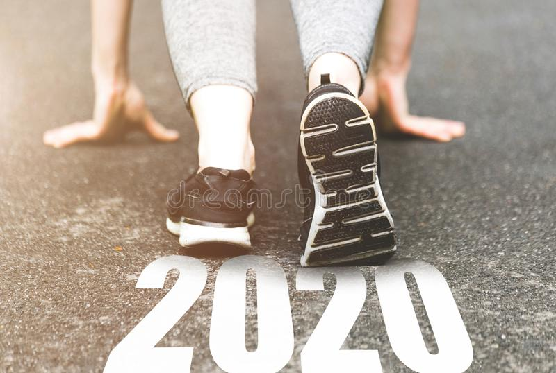 Beautiful girl in sports uniform running around. Healthy way of life, an infused figure. sneakers close-up, finish 2019. Start to stock photos