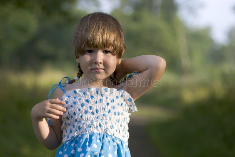 Beautiful girl spotted dress stock photo