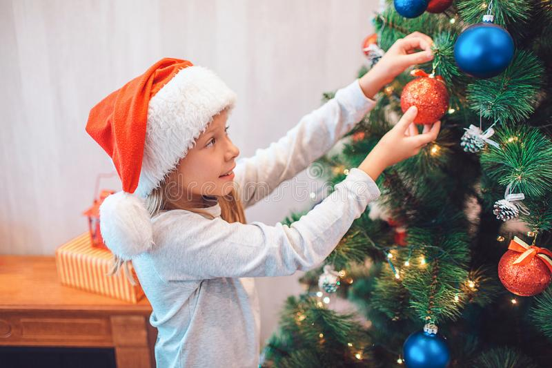 Dressing Christmas Tree Stock Photo. Image Of Cutie