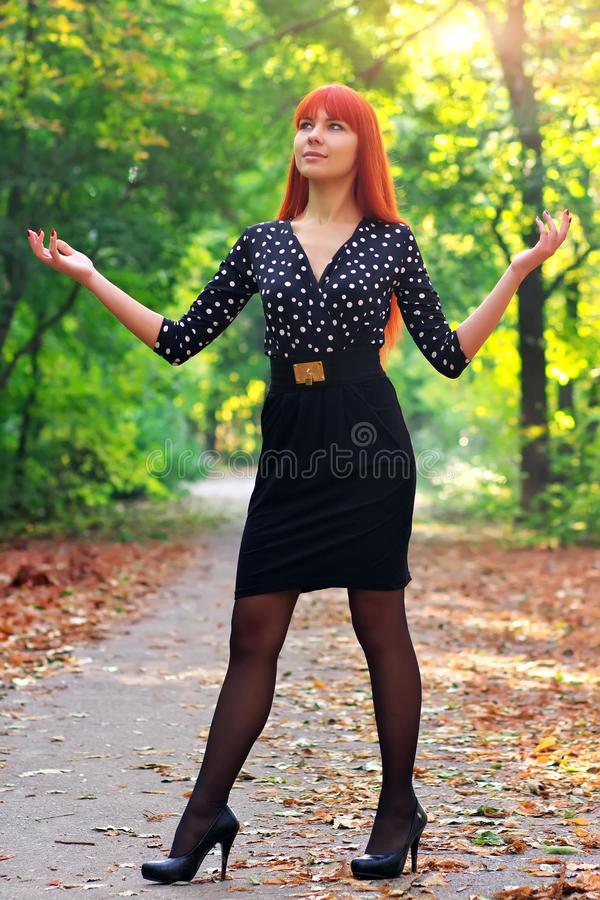 Download Beautiful Girl Standing In A Park In Autumn. Stock Image - Image: 35088671