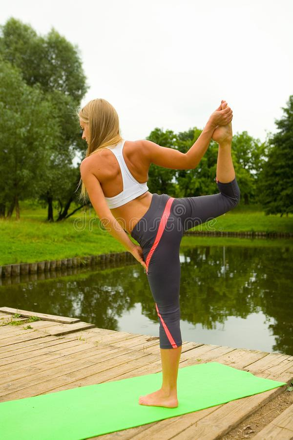 Beautiful girl standing in a pose asana. royalty free stock image