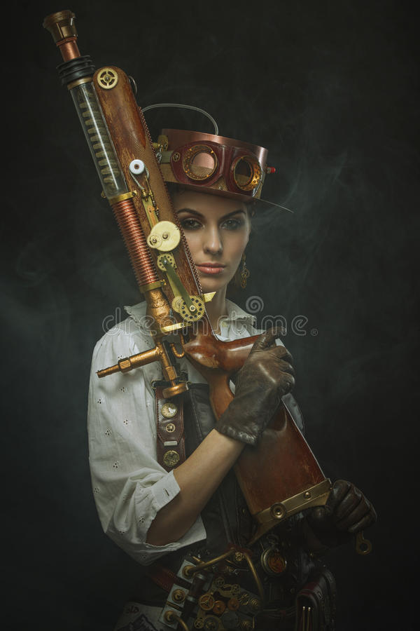 Beautiful girl steampunk in arms. royalty free stock image