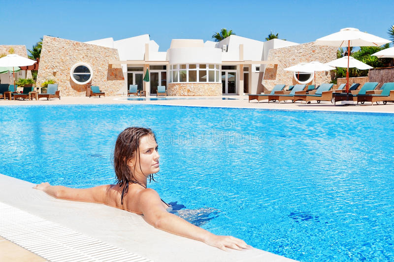 Beautiful girl submerged in the pool relaxing. In water in royalty free stock photography