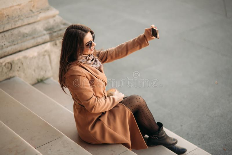 Beautiful girl in sunglasses make photo on smartphone. selfie royalty free stock photo