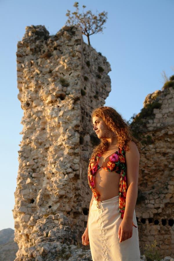 Beautiful girl at sunset stock photos