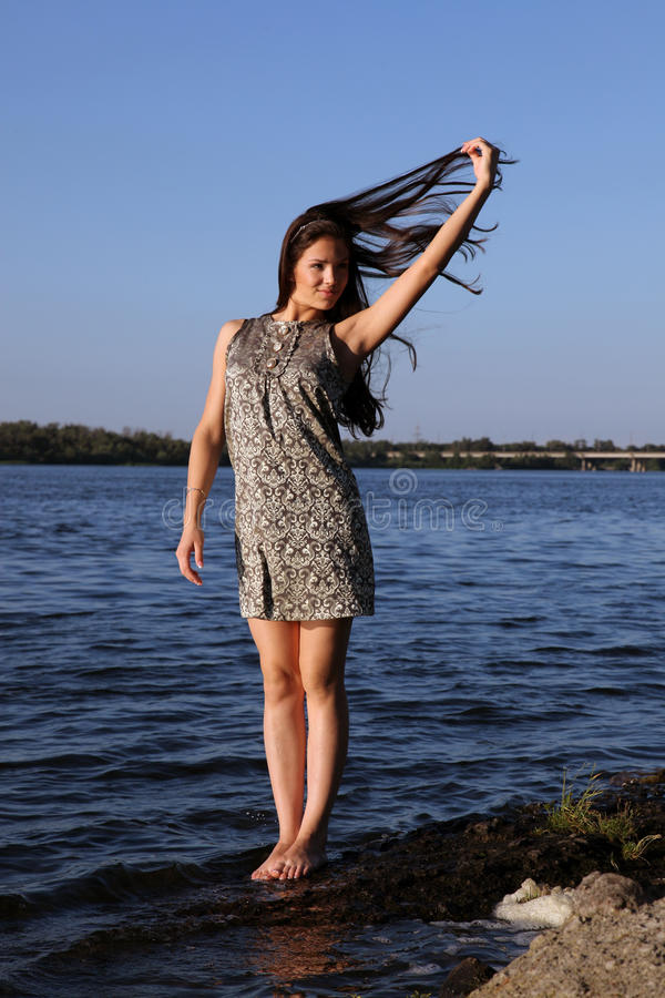 Beautiful girl at sunset time royalty free stock photography
