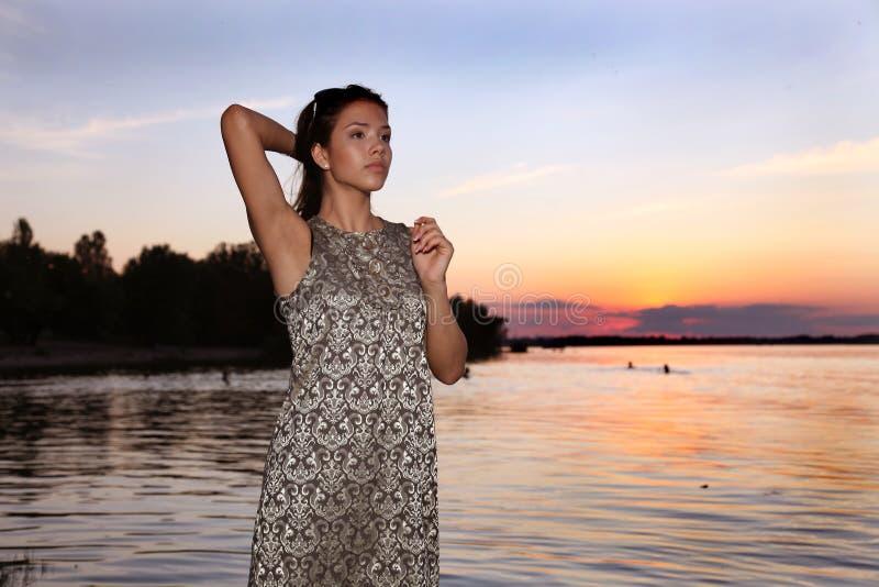 Beautiful girl at sunset time royalty free stock photos