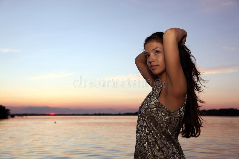 Beautiful girl at sunset time royalty free stock images