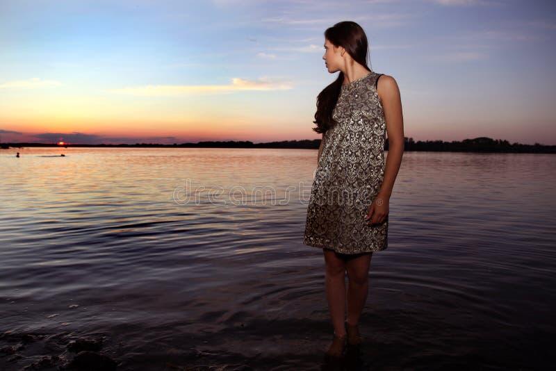 Beautiful girl at sunset time stock photo