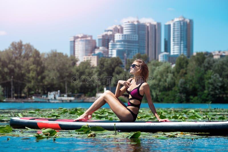 Beautiful girl on SUP board stock photo