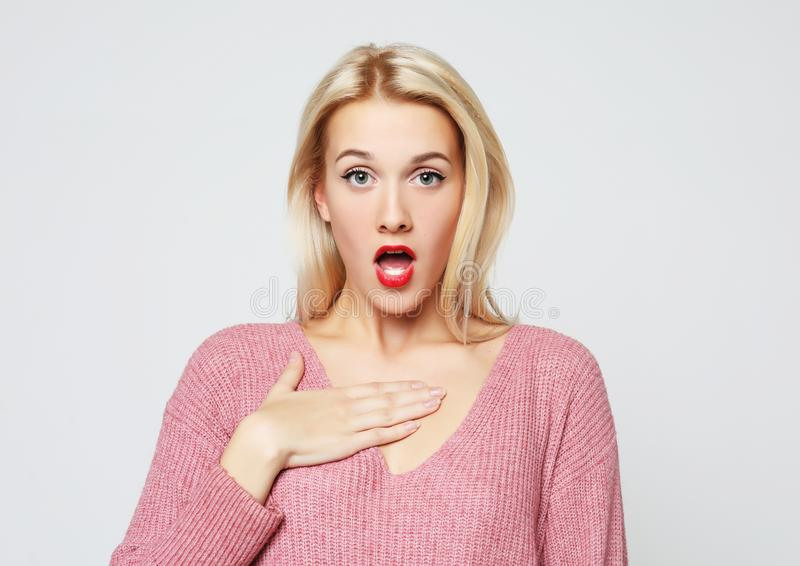 Beautiful girl surprised and shocked looks on you. royalty free stock image