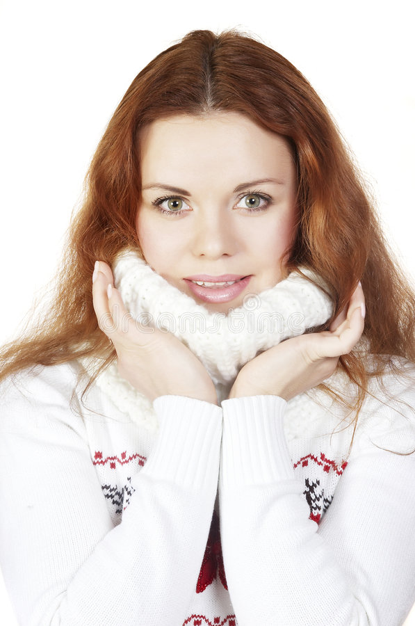 Beautiful girl in a sweater. Touches by hands face stock image