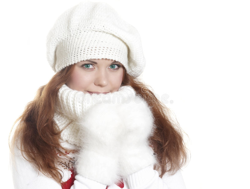Beautiful girl in a sweater. Touches by hands face royalty free stock photography