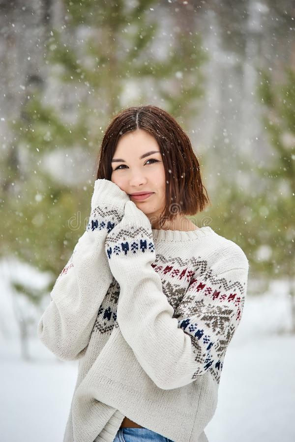 Teenage girl in the winter forest. Snowfall stock images