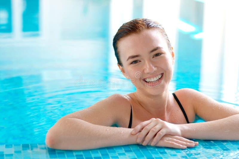 Beautiful girl in a swimming pool