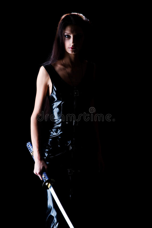 Beautiful girl with a sword stock photo