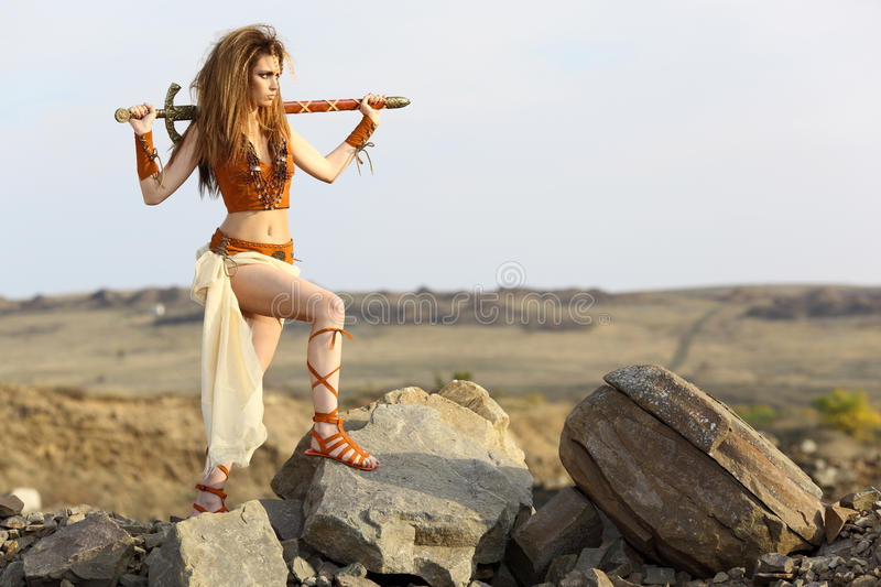 The beautiful girl with a sword royalty free stock photography