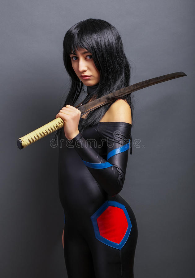Beautiful girl with sword. On grey background stock images