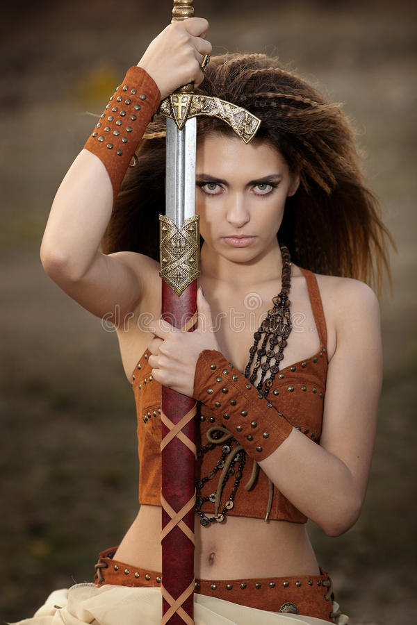 The beautiful girl with a sword. royalty free stock photo