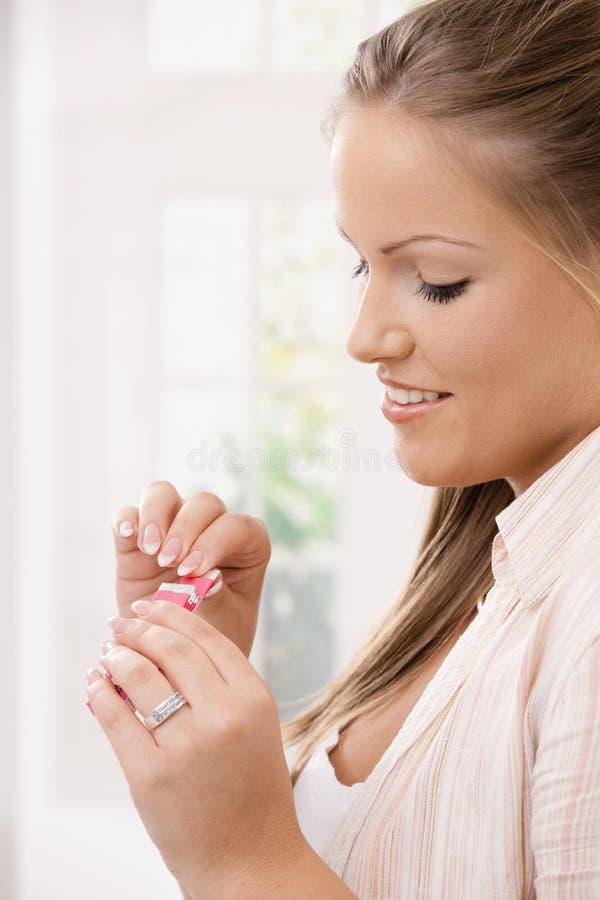 Beautiful girl taking pink chewing gum royalty free stock photo