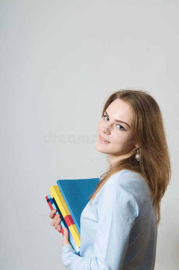 Beautiful girl with textbooks royalty free stock photography