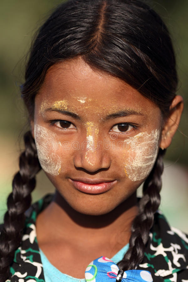 Beautiful girl with Thanaka, Myanmar royalty free stock photography