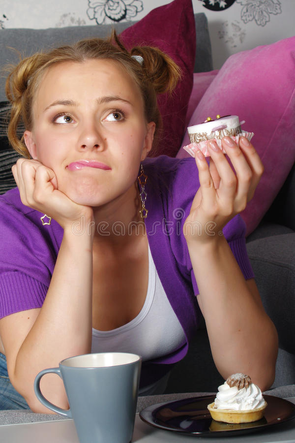 Download The Beautiful Girl Thinks To Eat A Pie Stock Photo - Image: 20467800