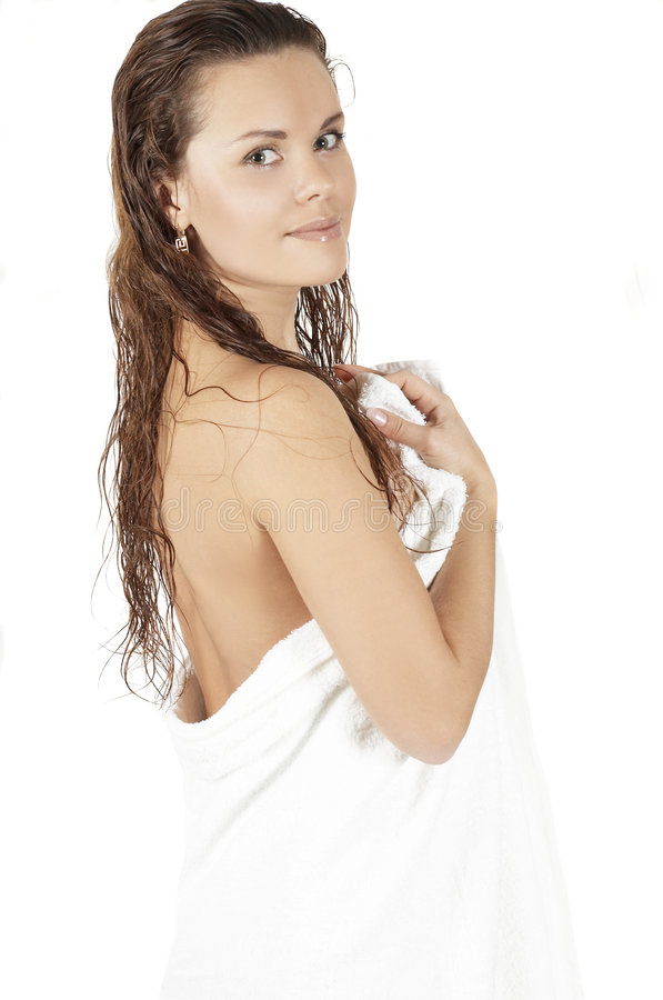 Beautiful girl with a towel. Portrait of the sexual woman in the ambassador by a bath royalty free stock photos