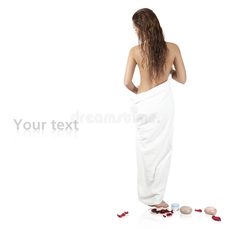Beautiful girl with a towel stands by a back. Portrait of the sexual woman in the ambassador by a bath stock images