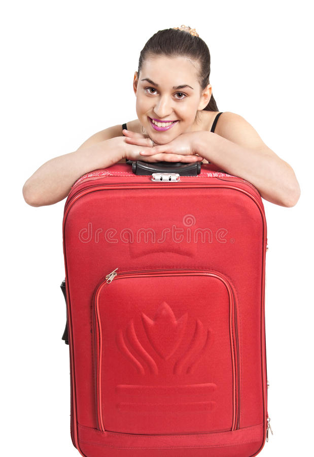 Beautiful girl with a travel bag stock photo