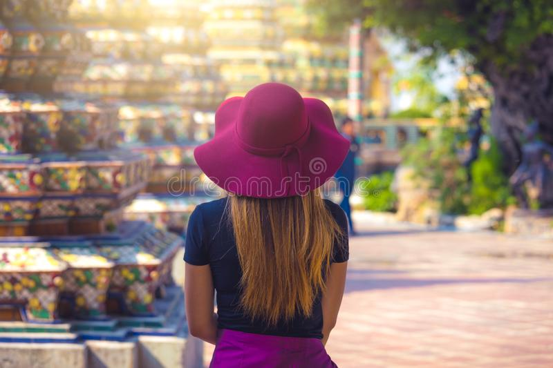 Beautiful girl traveler visiting a temple in Thailand during a sunny day . royalty free stock image