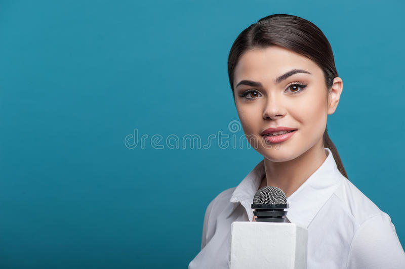 Beautiful girl TV journalist is interviewing and stock images