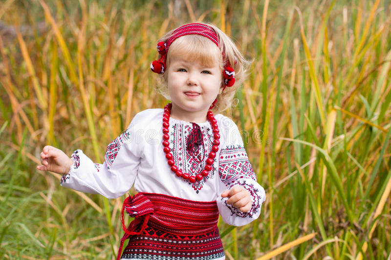 Download Beautiful Girl In Ukrainian Costume In A Field Stock Image - Image: 25577229