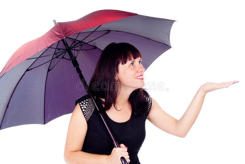 Beautiful Girl Under The Umbrella Of Checks Rain Stock Image