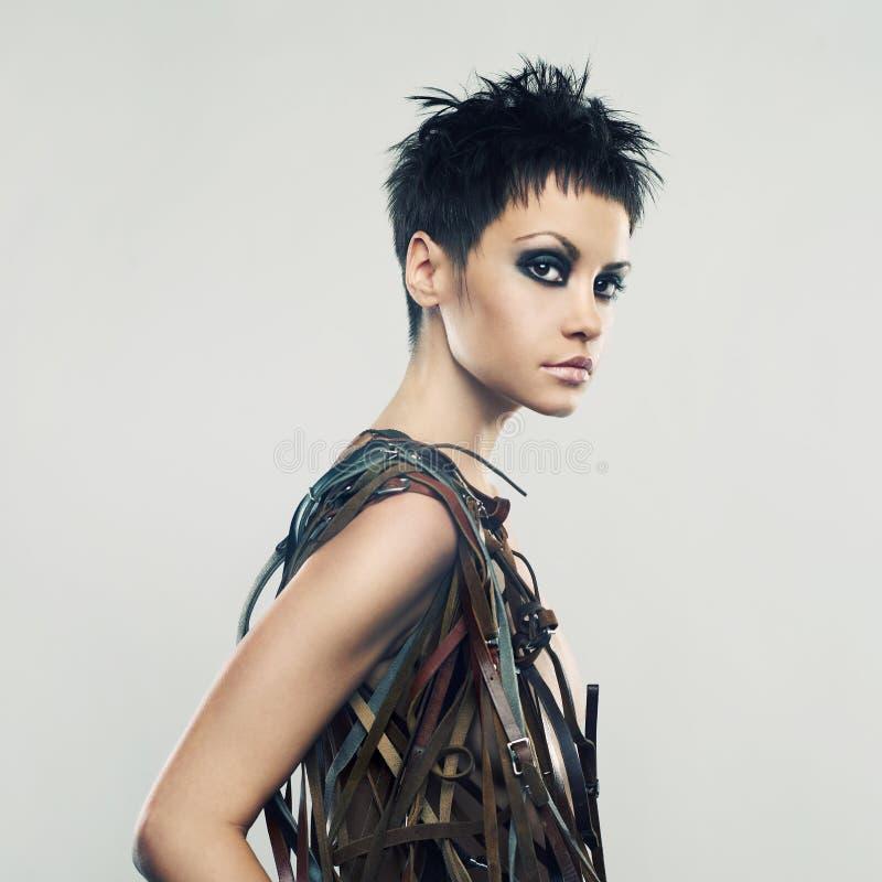Beautiful girl in an unusual dress stock image