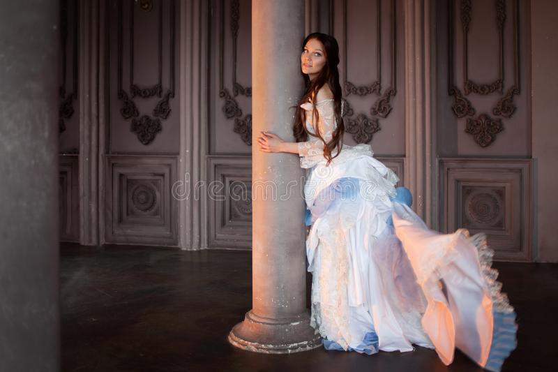 Beautiful girl in a vintage dress, in gloomy interior, Gothic and fairy tale royalty free stock images