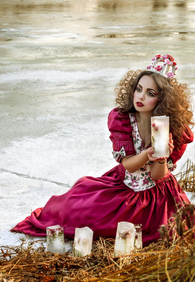 Beautiful girl in vintage red dress with a rose royalty free stock images