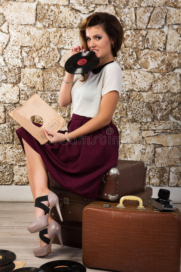 Beautiful girl with vintage vinyl records stock image