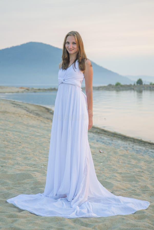 Beautiful girl walking on the beach. stock photo