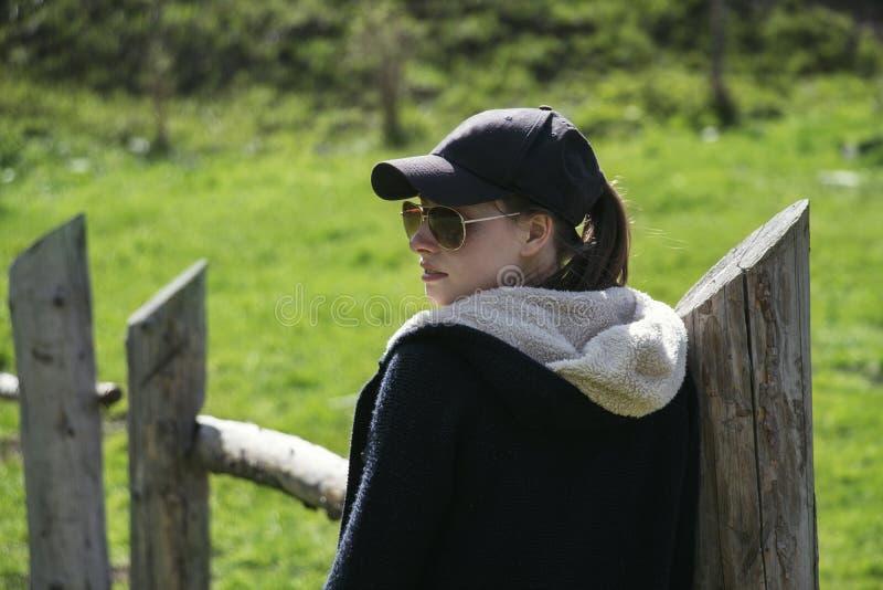 Beautiful girl is walking outdoors stock photo