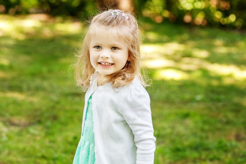 Beautiful girl walking in the park. Preschool child. 2-3 years. royalty free stock photography