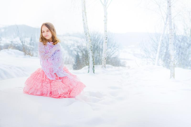 A beautiful girl walks on a frozen forest covered with snow royalty free stock photography