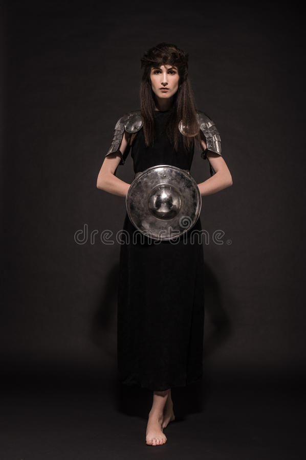 Beautiful Girl warrior in medieval clothes. In studio royalty free stock photos