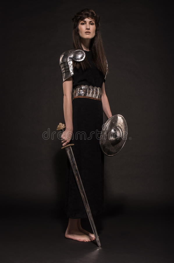 Beautiful Girl warrior in medieval clothes. In studio royalty free stock photo