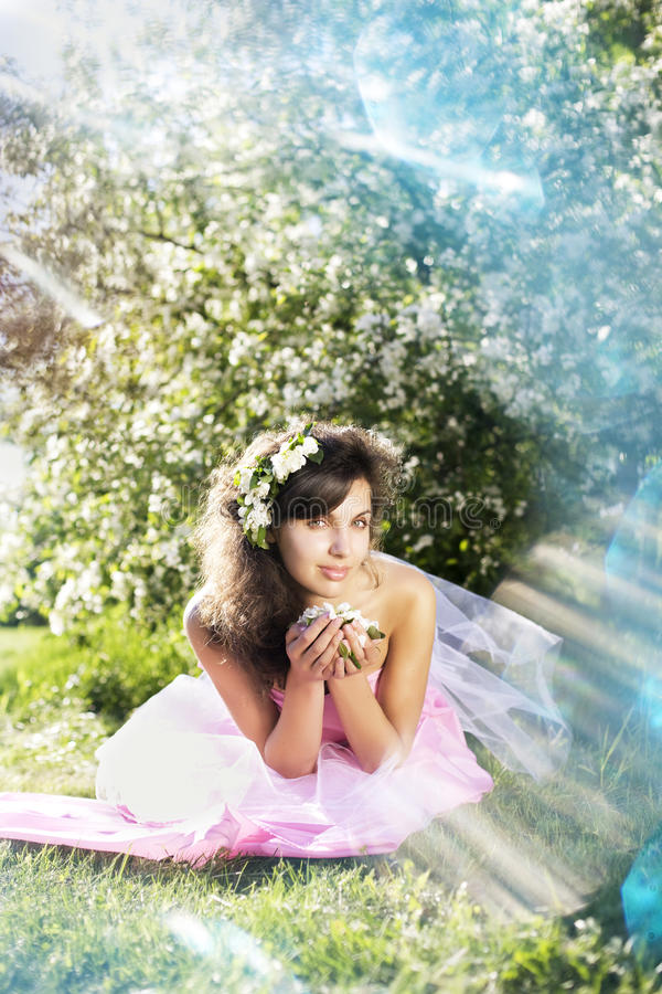 Beautiful girl was blossoming garden. The image of a beautiful girl was blossoming apple orchard stock photography