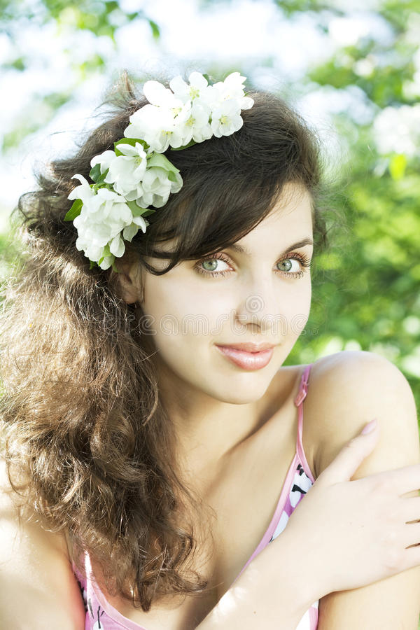 Beautiful girl was blossoming garden. The image of a beautiful girl was blossoming apple orchard royalty free stock photography