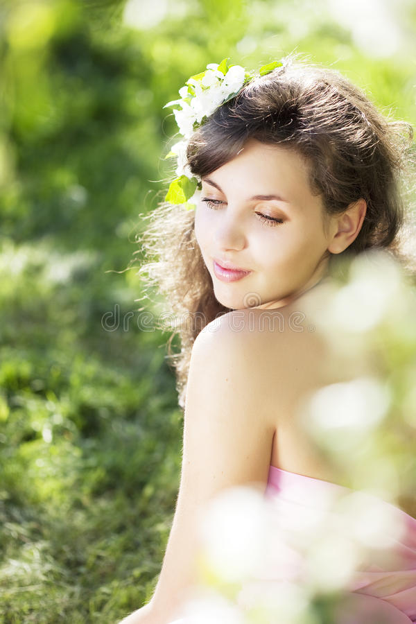 Beautiful girl was blossoming garden. The image of a beautiful girl was blossoming apple orchard royalty free stock images